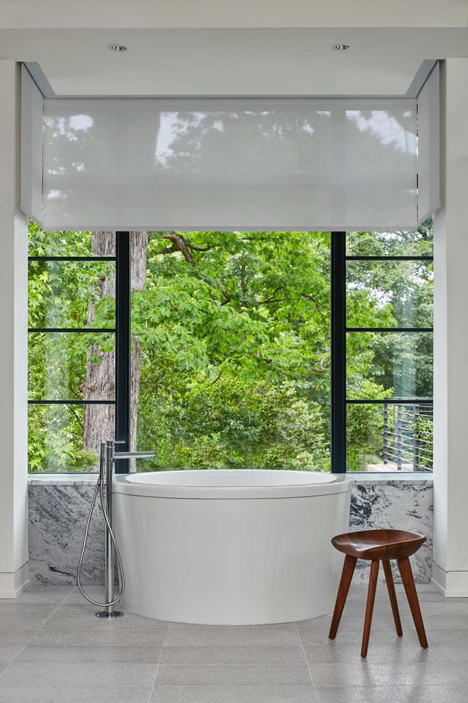 Hidden shades surrounding the bathtub.