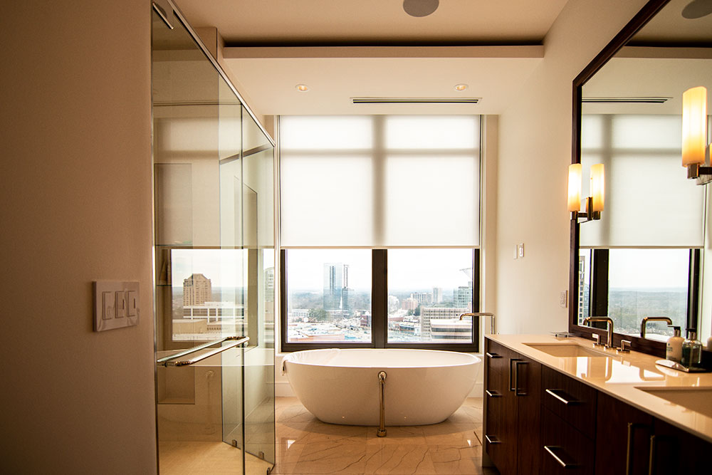 Bathroom automated window treatments